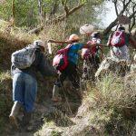 Farmers climbing volcano Santa Maria in Xela
