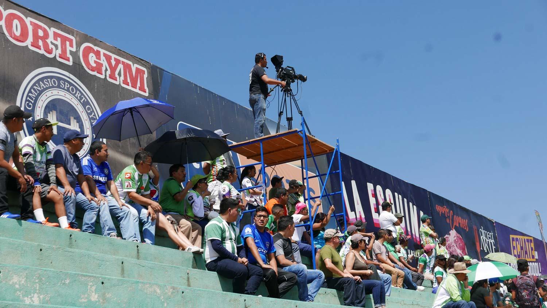 Camera man during football match in Antigua Guatemala