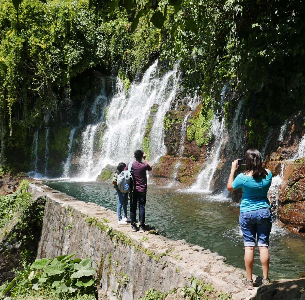 Tourists at one of the Los Chorros waterfalls near Juayua, El Salvador