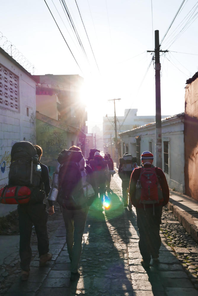 Early in the morning: making our way to the chicken bus through the streets of Xela