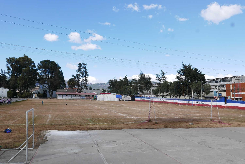 Football pitch near the former railway buildings, now museum of modern art, in Xela