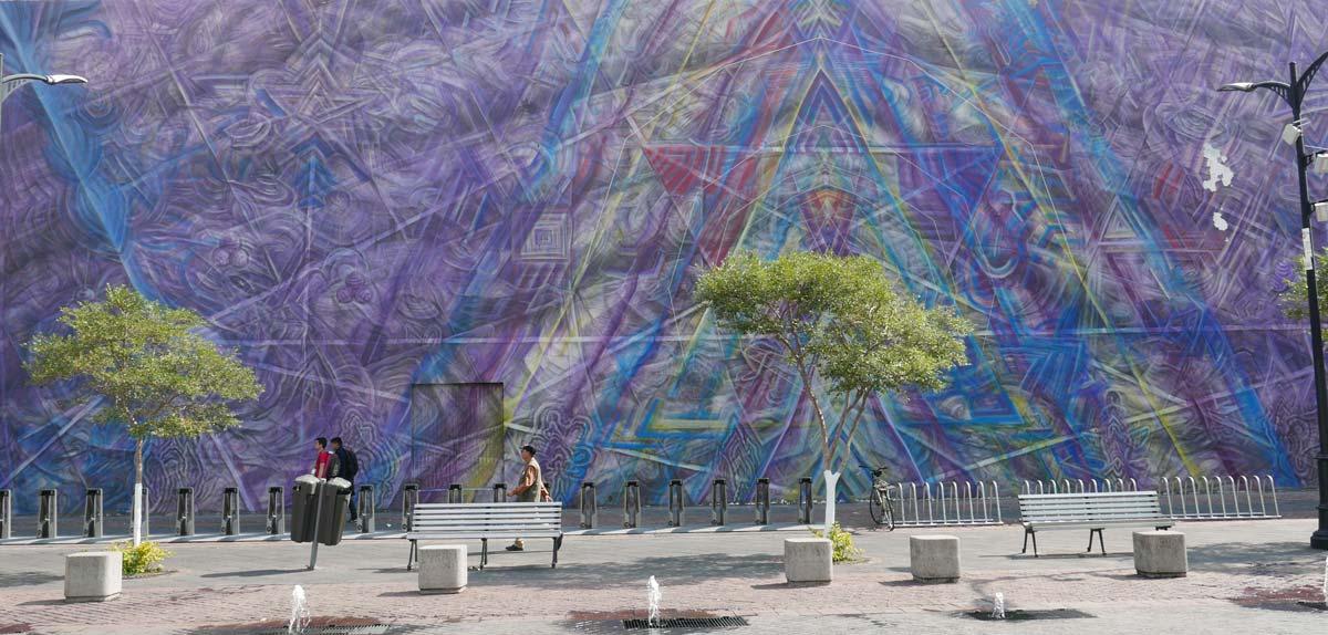 A wall full of street art near the MUSA museum in Guadalajara
