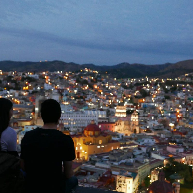 Couple overlooking the city centre of Guanajuato by night