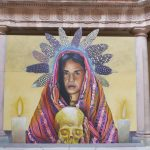 Painting in the courtyard of the Casa de Conde Rul museum in Guanajuato