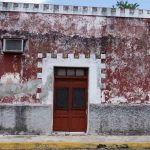 Red house with falling paint in Valladolid